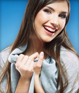 Smiling Invisalign patient shows off her straight teeth.