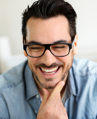 Smiling man shows off his Lumineers from Kennesaw dentist Dr. Anderson.